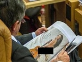 Politican caught ogling naked women in magazine during MPs' debate