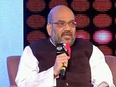 Come to Gujarat and fight polls against Modi, Amit Shah challenges Kejriwal