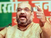 Election Commission examining Amit Shah's 'revenge' remarks, faces call for ban