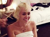 Miley Cyrus shares semi-naked selfie while getting a haircut