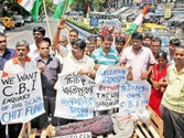 Congress activists at a mock funeral procession of Saradha Group chit fund company chief Sudipta Sen during an agitation demanding CBI enquiry into the fund scam, in Kolkata on Thursday. Photo: PTI.