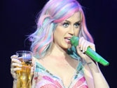Katy Perry shares beer with fan at London concert
