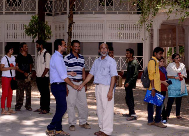 Shailendra Kushwaha, Dean of Faculty of Fine Arts, with his students