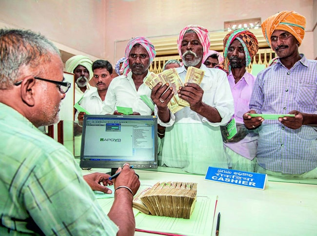 Farmers get loans at Grameena Vikas Bank in Dhanura village of Telangana's Medak district.