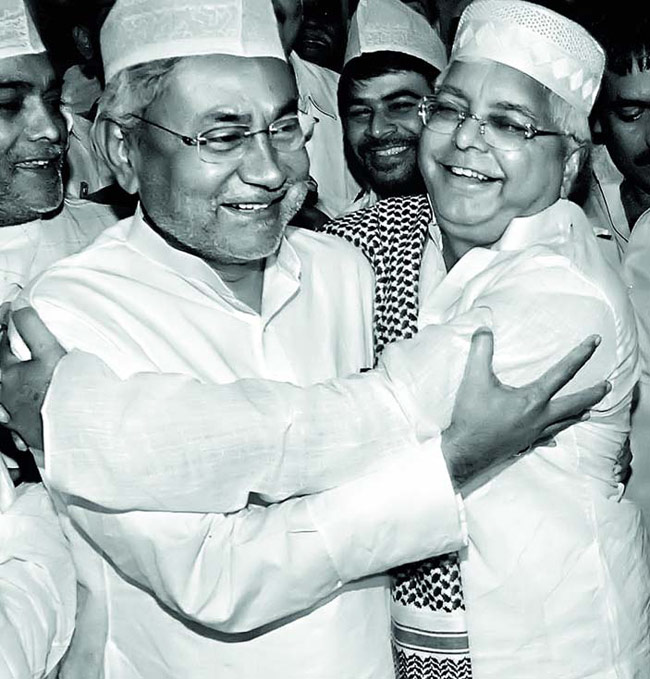 RJD chief Lalu Prasad Yadav with JD(U) leader Nitish Kumar at an Iftar party in Patna in 2006.