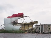 Malaysia Airlines MH17: Bodies from Ukraine crash site put in refrigerator trucks