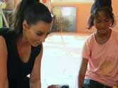 Is Kim trying to step into Jolie's shoes; wishes to adopt Thai child