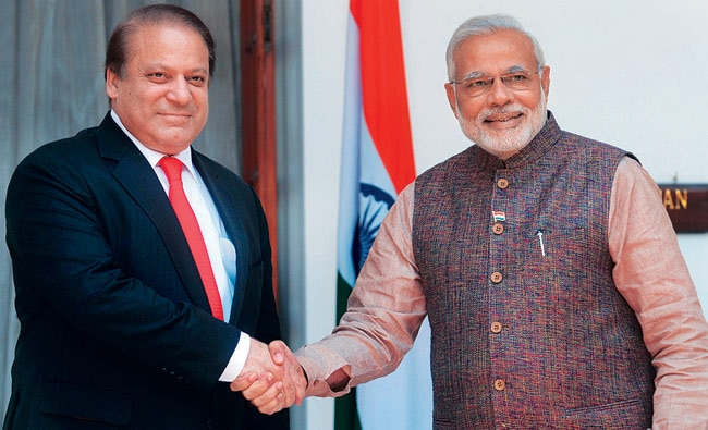 Prime Minister Narendra Modi shakes hands with his Pakistan counterpart Nawaz Sharif during the latter's visit to India in May.