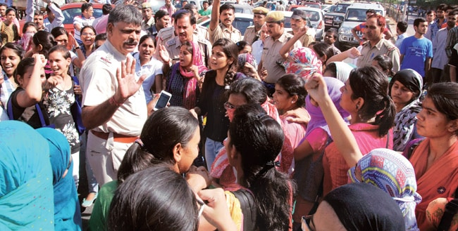 Students of Maharshi Dayanand University protest near the college campus at Sector 14 of Gurgaon.