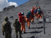 At least 36 feared dead on Japanese volcano, search called off