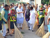 On Gandhi Jayanti, Modi wields broom, launches Swachh Bharat mission