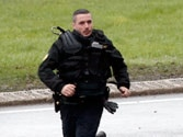 French police seal off town as they close in on newspaper killing suspects