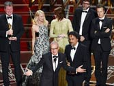 Michael Keaton, left, and Alejandro G. Inarritu, and the cast and crew of