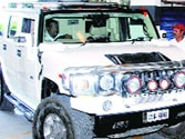 Beedi tycoon's Hummer runs over guard for delay in opening the gate