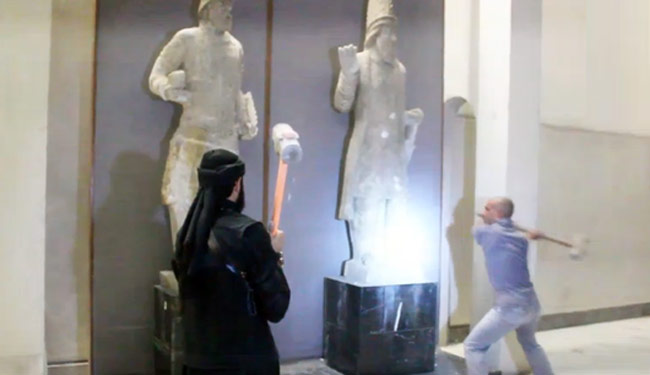 ISIS militants destroying ancient artifacts in Iraq