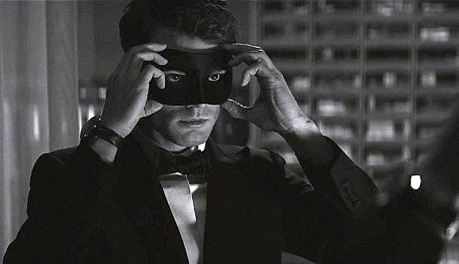 First look: Jamie Dornan puts on mask in Fifty Shades Darker