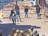 A file picture showing protesters clash with police against government's plan for setting up separate township for Kashmiri Pandits in Srinagar.