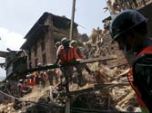 Nepalese army personnel clear the debris of a collapsed house as they carry out rescue operations following Saturday's earthquake in Nepal
