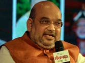 BJP govt delivering on its promises: Amit Shah