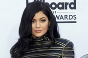 Kylie Jenner shares a selfie as she poses with a fake tan