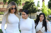 Kardashian sisters step out in all white