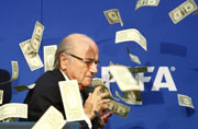 English comedian Simon Brodkin showers fake notes on FIFA chief Sepp Blatter