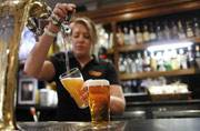 Up for a drink ladies? Cheers! Study says two beers a week can cut heart attack risk
