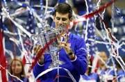 Novak Djokovic beats Roger Federer for second US Open title