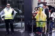 Apple fans brave Sydney rain as new iPhone 6s hit stores