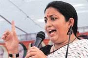 I challenge Sonia Gandhi, Rahul to arrest me: Smriti Irani