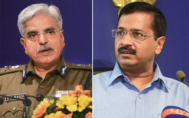 Delhi Police chief BS Bassi (L) with Kejriwal