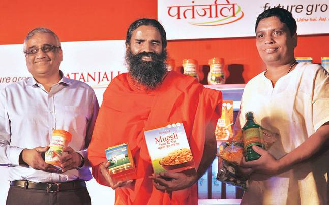 Baba Ramdev with Kishore Biyani (left) and Acharya Balkrishna