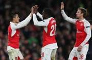 Sanchez double helps keep Arsenal's Champions League hopes alive
