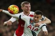 Arsenal earn late point against Spurs, City stay top