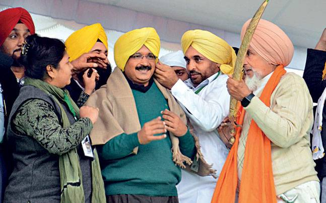 Delhi Chief Minister Arvind Kejriwal with AAP leaders at the Maghi Mela in Muktsar.