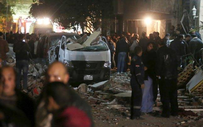 Damaged cars are seen at the scene of a bomb blast in Giza, Egypt. (Photo: Reuters)