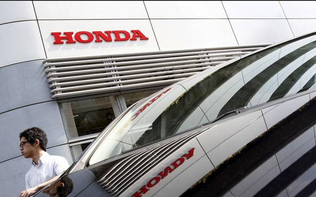 Honda quarterly profit slips on air-bag recall related costs