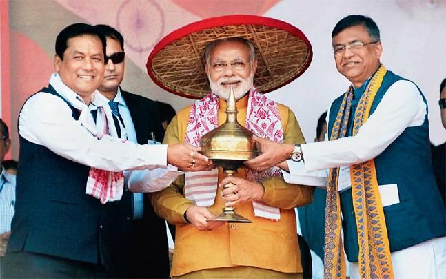 Narendra Modi (centre)