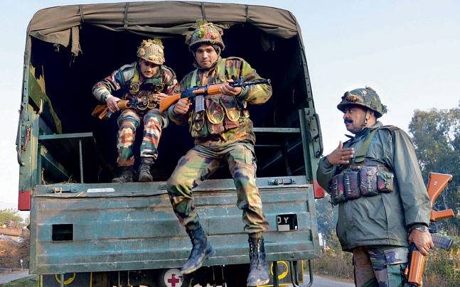 Armymen get ready for action at the air force base in Pathankot on Sunday following attack by gunmen.