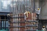 Workers at an under-construction building. (Reuters photo)