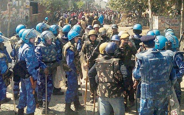 Security try to control protestors in Sonepat