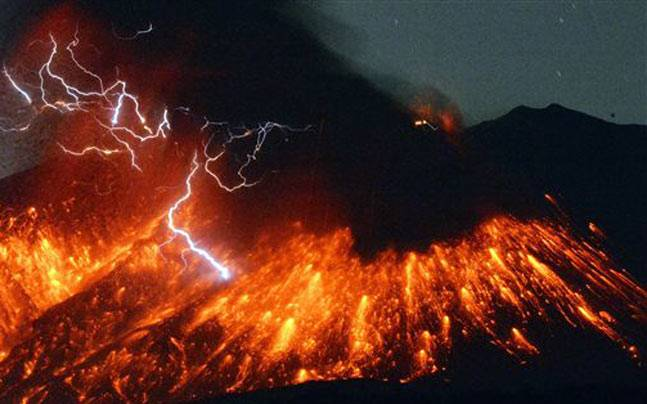 Lightning flashes above flowing lava as Sakurajima erupts (Photo: AP)