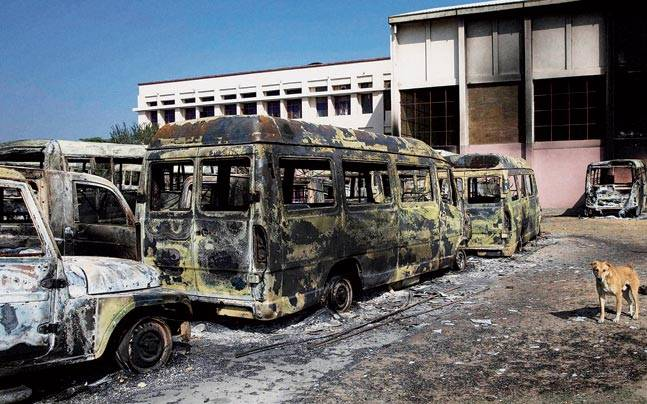 Charred vehicles pile up in Rohtak on Sunday