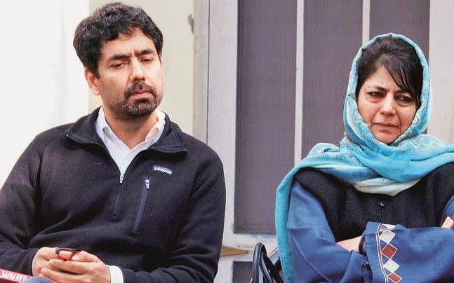 Mehbooba Mufti with her brother Tasaduq Hussain Sayeed during a party meeting in Jammu on Friday.