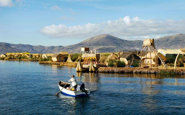 A local rows a boat next to the shores of Uros Islands on Lake Titicaca. Picture courtesy: Reuters