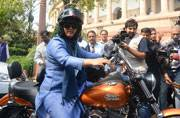 Woman Congress MP nailed the swagger quotient by riding a Harley freaking Davidson to the Parliament