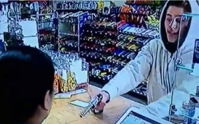 YouTube grab showing Bhumika Patel fighting off a robber at her store in Georgia, United States.