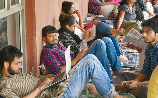 JNU Students' Union president Kanhaiya Kumar, Umar Khalid and others at the university's admin block on Thursday.