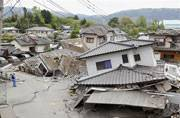 Japan earthquakes kill 32, residents still trapped