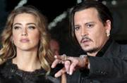 WATCH: Johnny Depp's wife Amber Heard pleads guilty in dog smuggling case in this bizarre video